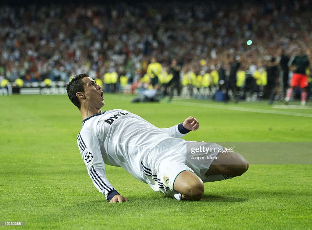 <a gi-track='captionPersonalityLinkClicked' href=/galleries/search?phrase=Cristiano+Ronaldo+-+Soccer+Player&family=editorial&specificpeople=162689 ng-click='$event.stopPropagation()'>Cristiano Ronaldo</a> of Real Madrid celebrates scoring his sides winning goal during the UEFA Champions League group D match between Real Madrid and Manchester City FC at the Estadio Santiago Bernabeu on September 18, 2012 in Madrid, Spain.