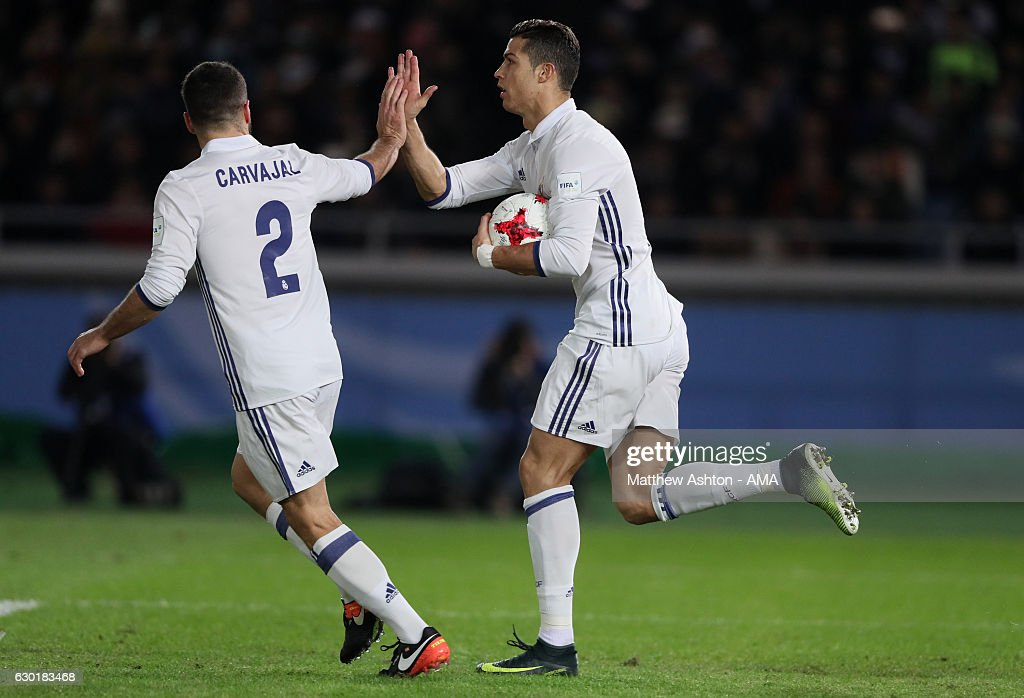 Cristiano Ronaldo of Real Madrid celebrates scoring his team's second goal to make the score 2-2 with Daniel Carvajal during the FIFA Club World Cup final match between Real Madrid and Kashima Antlers at International Stadium Yokohama on December 18, 2016 in Yokohama, Japan.