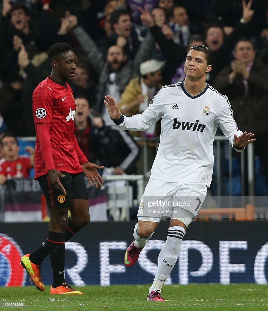 <a gi-track='captionPersonalityLinkClicked' href=/galleries/search?phrase=Cristiano+Ronaldo&family=editorial&specificpeople=162689 ng-click='$event.stopPropagation()'>Cristiano Ronaldo</a> of Real Madrid celebrates scoring their first goal during the UEFA Champions League Round of 16 first leg match between Real Madrid and Manchester United at Estadio Santiago Bernabeu on February 13, 2013 in Madrid, Spain.