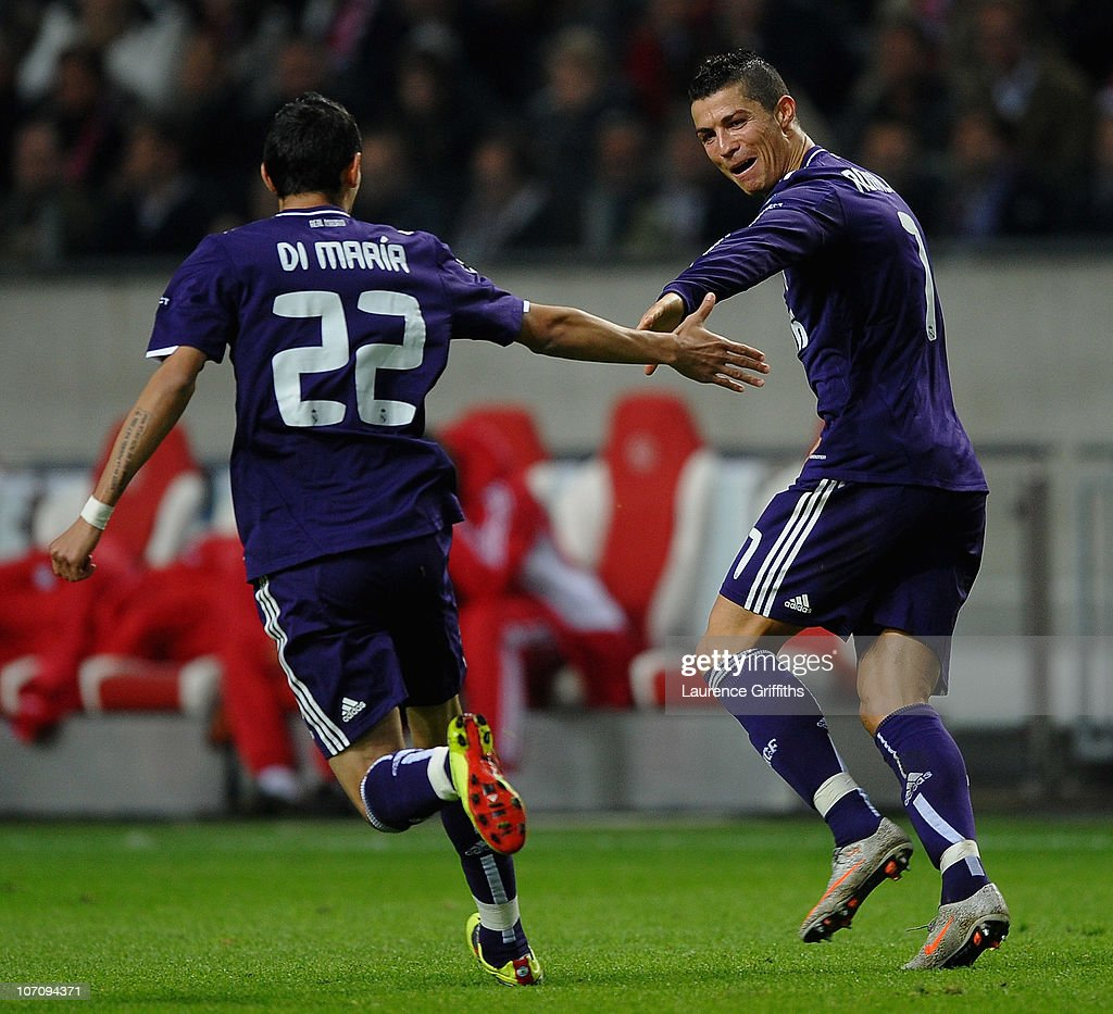 <a gi-track='captionPersonalityLinkClicked' href=/galleries/search?phrase=Cristiano+Ronaldo+-+Soccer+Player&family=editorial&specificpeople=162689 ng-click='$event.stopPropagation()'>Cristiano Ronaldo</a> of Real Madrid celebrates the third goal with <a gi-track='captionPersonalityLinkClicked' href=/galleries/search?phrase=Angel+Di+Maria&family=editorial&specificpeople=4110691 ng-click='$event.stopPropagation()'>Angel Di Maria</a> during the UEFA Champions League Group G match between AFC Ajax and Real Madrid at the Ajax Arena on November 23, 2010 in Amsterdam, Netherlands.