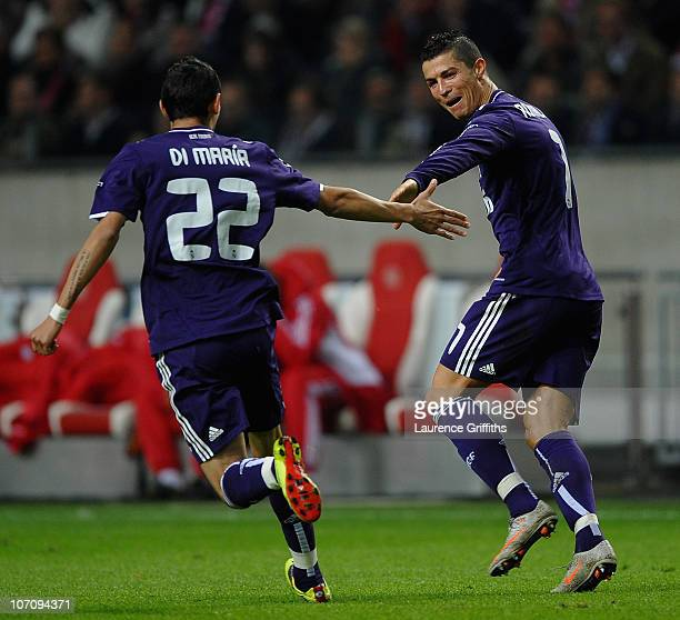 Cristiano Ronaldo of Real Madrid celebrates the third goal with Angel Di Maria during the UEFA Champions League Group G match between AFC Ajax and...
