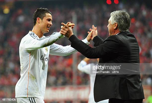 Cristiano Ronaldo of Real Madrid celebrates victory with Carlo Ancelotti coach of Real Madrid after the UEFA Champions League Semi Final second leg...