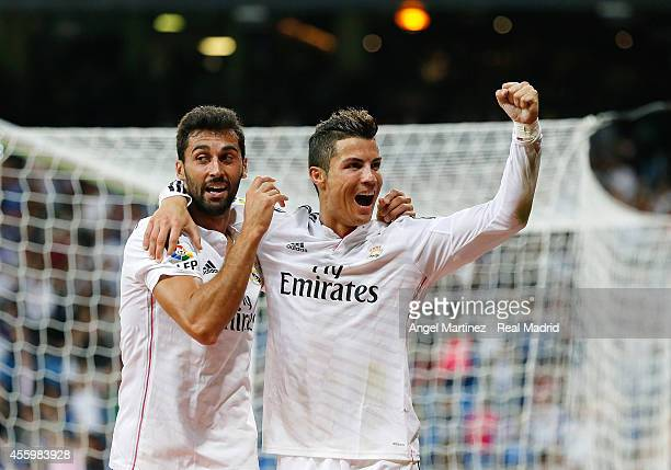 Cristiano Ronaldo of Real Madrid celebrates with Alvaro Arbeloa after scoring their team's fifth goal during the La Liga match between Real Madrid CF...