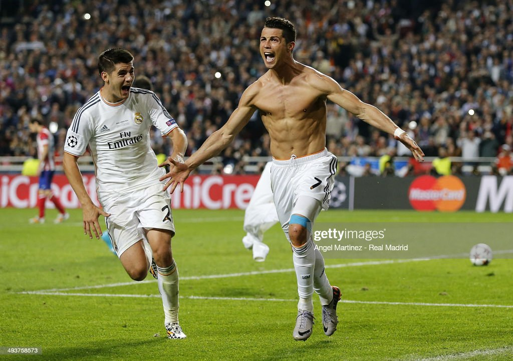Cristiano Ronaldo (R) of Real Madrid celebrates with Alvaro Morata scoring their fourth goal from the penalty spot during the UEFA Champions League Final between Real Madrid and Atletico de Madrid at Estadio da Luz on May 24, 2014 in Lisbon, Portugal.