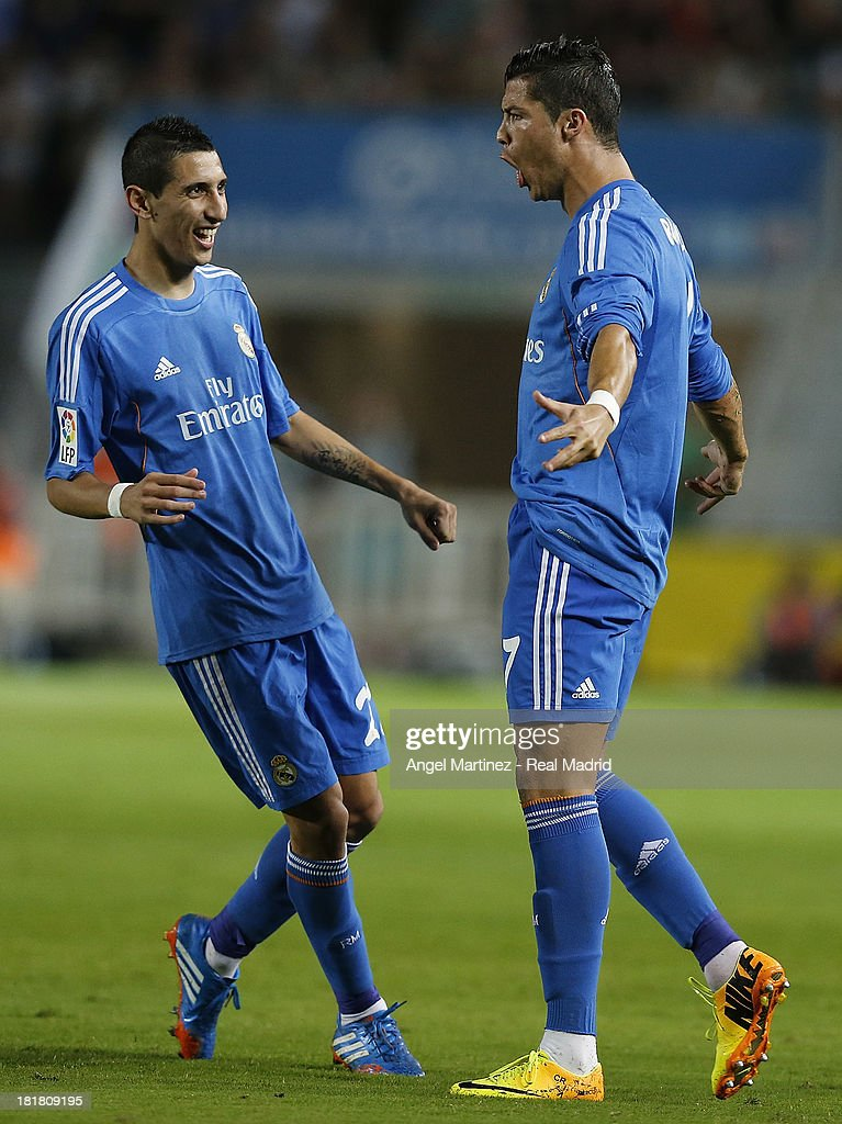 <a gi-track='captionPersonalityLinkClicked' href=/galleries/search?phrase=Cristiano+Ronaldo+-+Soccer+Player&family=editorial&specificpeople=162689 ng-click='$event.stopPropagation()'>Cristiano Ronaldo</a> (R) of Real Madrid celebrates with Angel di Maria after scoring the opening goal during the La Liga match between Elche FC and Real Madrid at Estadio Manuel Martinez Valero on September 25, 2013 in Elche, Spain.