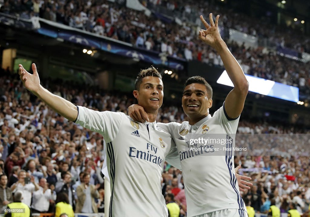 Cristiano Ronaldo (L) of Real Madrid celebrates with Casemiro their team's third goal during the UEFA Champions League Semi Final first leg match between Real Madrid CF and Club Atletico de Madrid at Estadio Santiago Bernabeu on May 2, 2017 in Madrid, Spain.