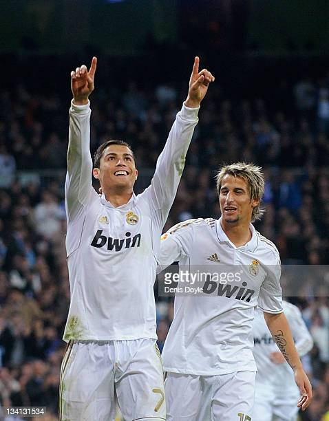 Cristiano Ronaldo of Real Madrid celebrates with Fabio Coentrao after scoring Real's 4th goal during the La Liga match between Real Madrid and...