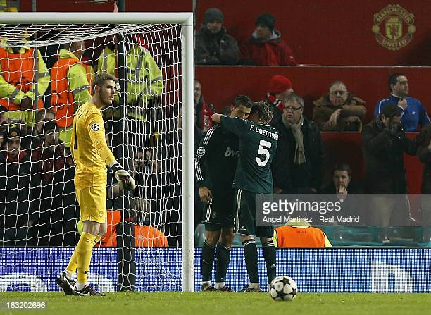 Cristiano Ronaldo of Real Madrid celebrates with Fabio Coentrao after scoring their second goal during the UEFA Champions League Round of 16 second...