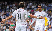 Cristiano Ronaldo of Real Madrid celebrates with Gareth Bale after scoring Real's 3rd goal during the UEFA Champions League Group B match between...
