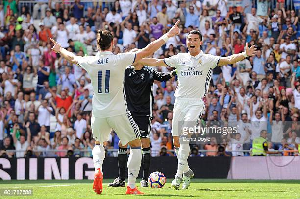 Cristiano Ronaldo of Real Madrid celebrates with Gareth Bale after scoring opening goal during the La Liga match between Real Madrid CF and CA...