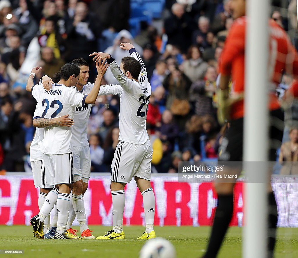 Cristiano Ronaldo (2nd R) of Real Madrid celebrates with Gonzalo Higuain (L), Angel di Maria and Marcelo Vieira (R) after scoring their team's third goal during the La Liga match between Real Madrid and Levante at Estadio Santiago Bernabeu on April 6, 2013 in Madrid, Spain.