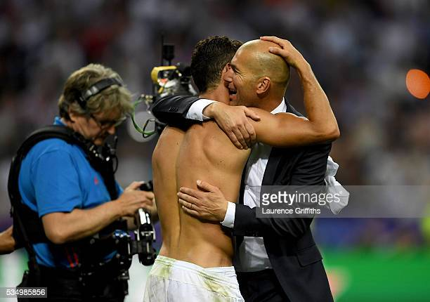 Cristiano Ronaldo of Real Madrid celebrates with head coach Zinedine Zidane after the UEFA Champions League Final match between Real Madrid and Club...