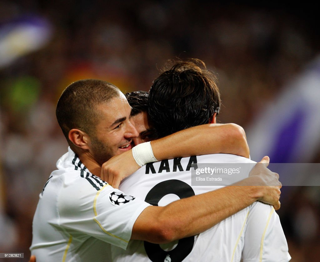 Cristiano Ronaldo of Real Madrid celebrates with his team mates Karim Benzema and Kaka during the UEFA Champions League Group C match between Real...