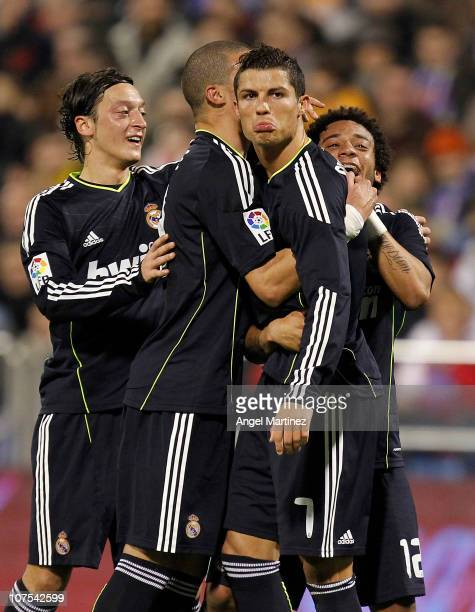 Cristiano Ronaldo of Real Madrid celebrates with his team mates Pepe Mezut Ozil and Marcelo Vieira after scoring Real's second goal during the La...