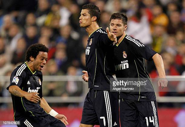 Cristiano Ronaldo of Real Madrid celebrates with his team mates Xabi Alonso and Marcelo VIeira after scoring Real's second goal during the La Liga...
