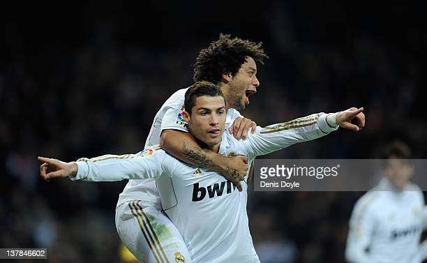 Cristiano Ronaldo of Real Madrid celebrates with his teammate Marcelo after scoring Real's 2nd goal during the La Liga match between Real Madrid and...