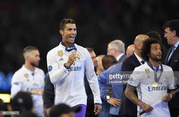 Cristiano Ronaldo of Real Madrid celebrates with his winners medal after victory in the UEFA Champions League Final between Juventus and Real Madrid...