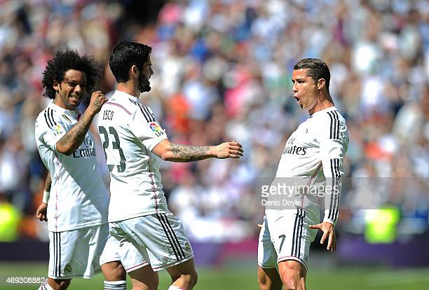 Cristiano Ronaldo of Real Madrid celebrates with Isco and Marcelo after scoring Real's opening goal from a free kick during the La Liga match between...