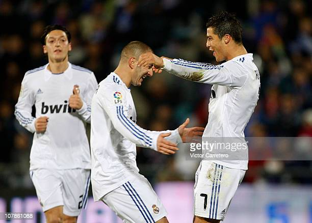 Cristiano Ronaldo of Real Madrid celebrates with Karim Benzema after scoring Real's third goal during La Liga match between Getafe and Real Madrid at...