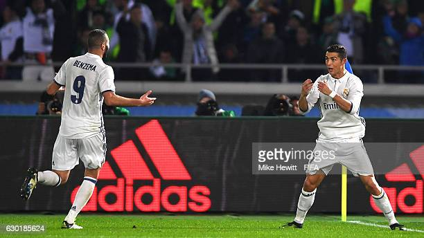 Cristiano Ronaldo of Real Madrid celebrates with Karim Benzema after scoring his sides third goal during the FIFA Club World Cup Final match between...
