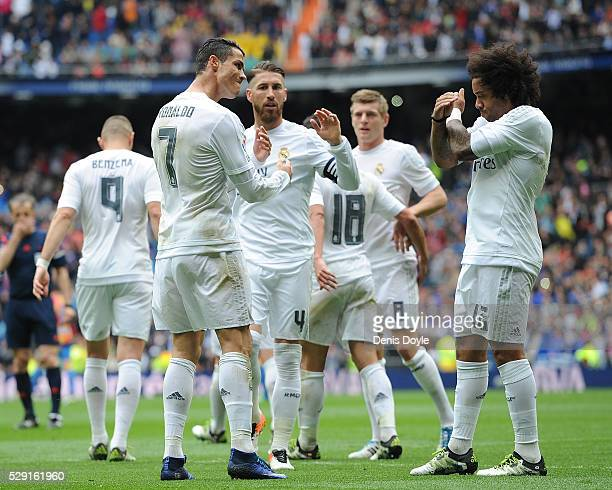 Cristiano Ronaldo of Real Madrid celebrates with Marcelo after scoring his team's opening goal during the La Liga match between Real Madrid CF and...