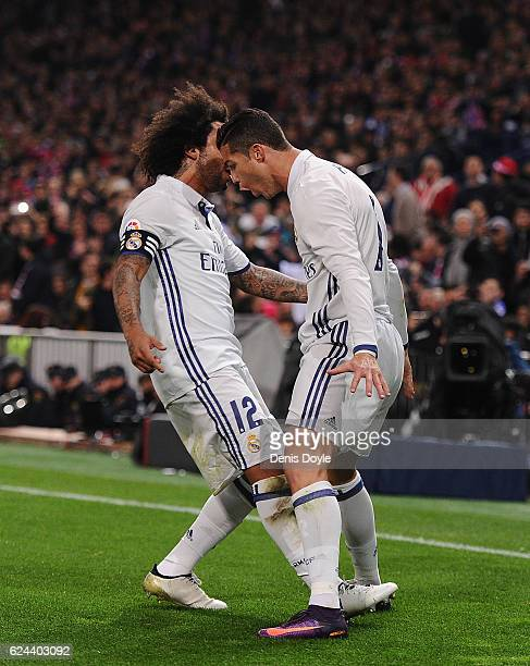Cristiano Ronaldo of Real Madrid celebrates with Marcelo after scoring Real's first goal during the La Liga match between Club Atletico de Madrid and...