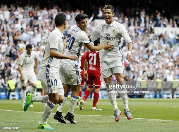 Cristiano Ronaldo of Real Madrid celebrates with Marco Asensio and James Rodriguez after scoring their team's second goal during the La Liga match...