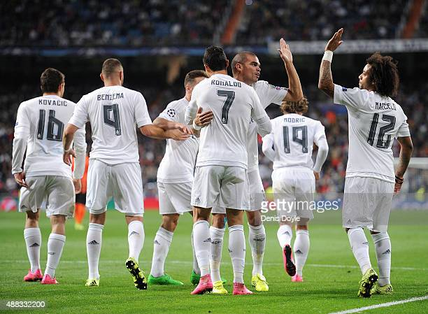 Cristiano Ronaldo of Real Madrid celebrates with Pepe after scoring Real's 2nd goal from the penalty spot during the UEFA Champions League Group A...