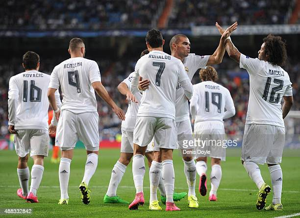 Cristiano Ronaldo of Real Madrid celebrates with Pepe and Marcelo after scoring Real's 2nd goal from the penalty spot during the UEFA Champions...