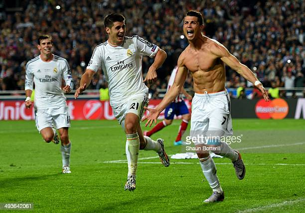 Cristiano Ronaldo of Real Madrid celebrates with r21 after scoring their fourth goal from the penalty spot during the UEFA Champions League Final...