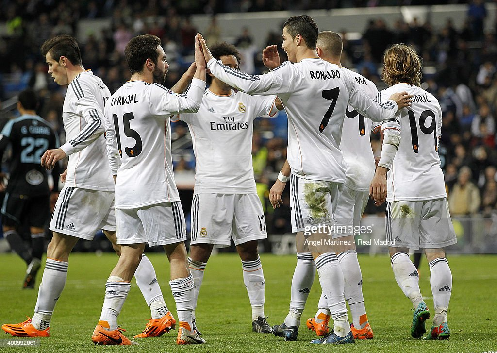 Cristiano Ronaldo (3nd R) of Real Madrid celebrates with team mates after scoring their team's third goal during the La Liga match between Real Madrid and RC Celta de Vigo at Estadio Santiago Bernabeu on January 6, 2014 in Madrid, Spain.