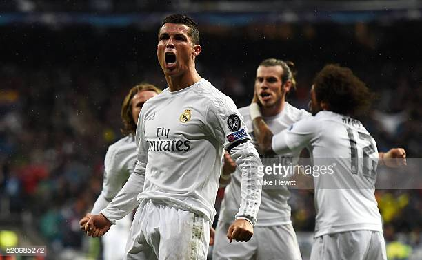Cristiano Ronaldo of Real Madrid celebrates with team mates as he scores their second goal during the UEFA Champions League quarter final second leg...