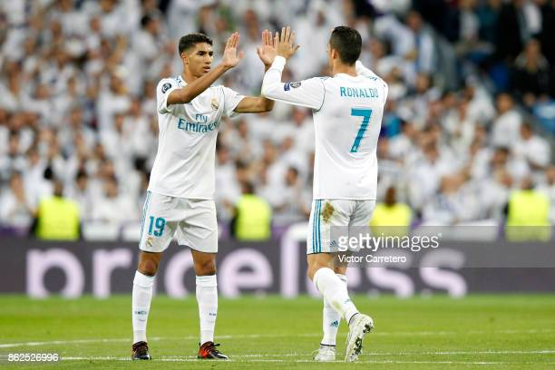 Cristiano Ronaldo of Real Madrid celebrates with teammate Achraf Hakimi after scoring his team's first goal during the UEFA Champions League group H...