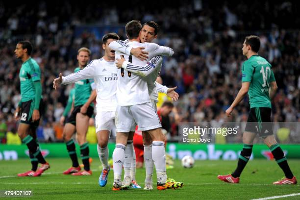 Cristiano Ronaldo of Real Madrid celebrates with teammate Gareth Bale after scoring the opening goal during the UEFA Champions League Round of 16...