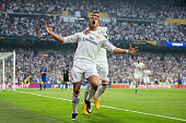 Cristiano Ronaldo of Real Madrid celebrates with teammate Sergio Ramos of Real Madrid after scoring the opening goal from the penalty spot during the...