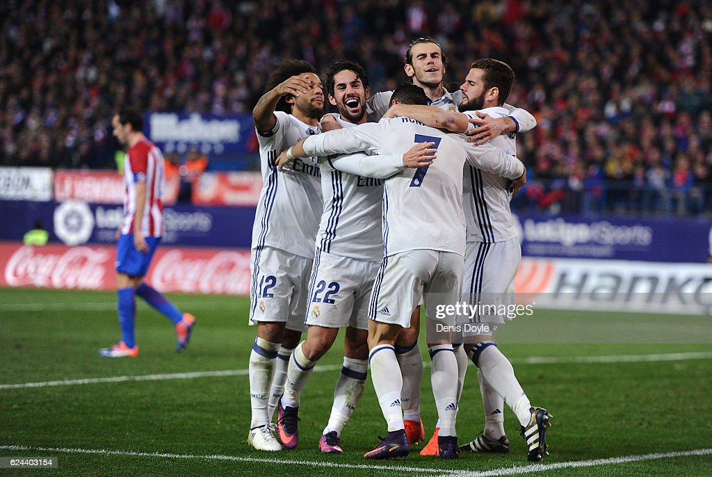 Cristiano Ronaldo of Real Madrid celebrates with teammates after scoring Real's 3rd goal during the La Liga match between Club Atletico de Madrid and Real Madrid CF at Vicente Calderon Stadium on November 19, 2016 in Madrid, Spain.
