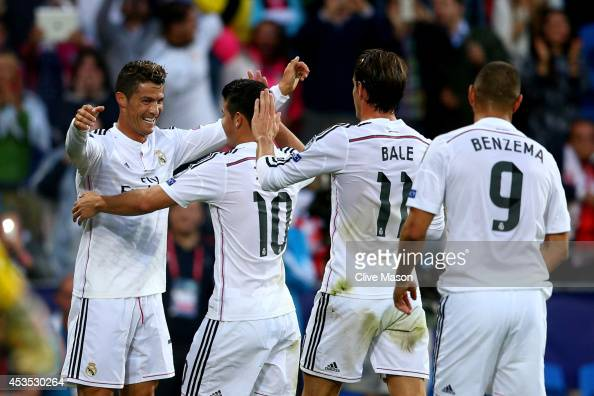 Cristiano Ronaldo of Real Madrid celebrates with teammates James Rodriguez Gareth Bale and Karim Benzema after scoring the opening goal during the...