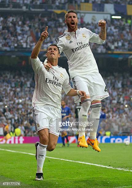 Cristiano Ronaldo of Real Madrid celebrates with teammates Sergio Ramos of Real Madrid after scoring the opening goal from the penalty spot during...