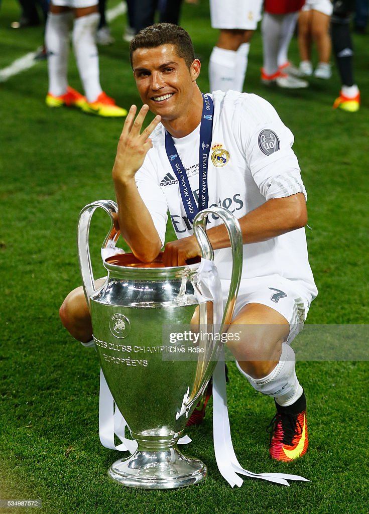 <a gi-track='captionPersonalityLinkClicked' href=/galleries/search?phrase=Cristiano+Ronaldo+-+Soccer+Player&family=editorial&specificpeople=162689 ng-click='$event.stopPropagation()'>Cristiano Ronaldo</a> of Real Madrid celebrates with the Champions League Trophy and gestures that it is his third time winning it after the UEFA Champions League Final match between Real Madrid and Club Atletico de Madrid at Stadio Giuseppe Meazza on May 28, 2016 in Milan, Italy.