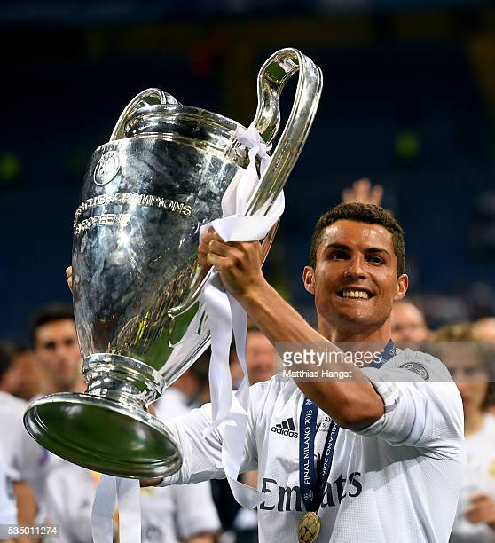 Cristiano Ronaldo of Real Madrid celebrates with the Champions League trophy after the UEFA Champions League Final match between Real Madrid and Club...