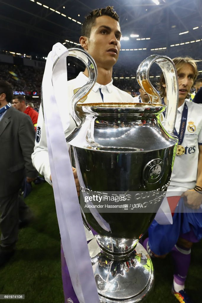 Cristiano Ronaldo of Real Madrid celebrates with The Champions League trophy after the UEFA Champions League Final between Juventus and Real Madrid at National Stadium of Wales on June 3, 2017 in Cardiff, Wales.