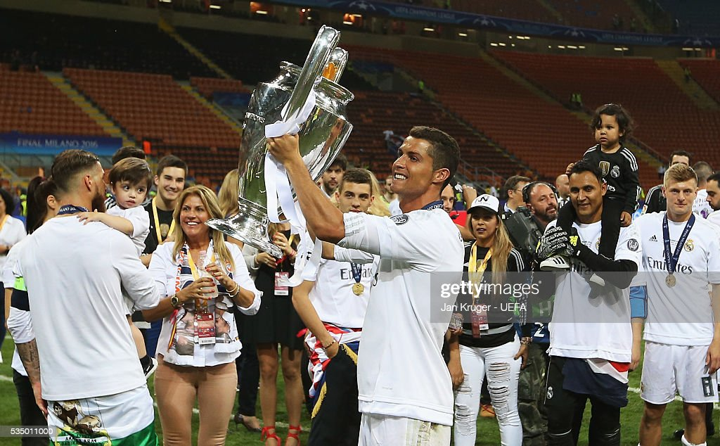 <a gi-track='captionPersonalityLinkClicked' href=/galleries/search?phrase=Cristiano+Ronaldo+-+Soccer+Player&family=editorial&specificpeople=162689 ng-click='$event.stopPropagation()'>Cristiano Ronaldo</a> of Real Madrid celebrates with the trophy after the UEFA Champions League Final between Real Madrid and Club Atletico de Madrid at Stadio Giuseppe Meazza on May 28, 2016 in Milan, Italy.
