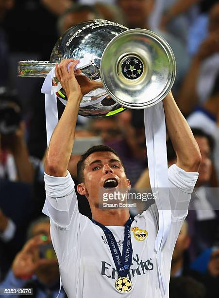 Cristiano Ronaldo of Real Madrid celebrates wth the trophy after victory in the UEFA Champions League Final match between Real Madrid and Club...