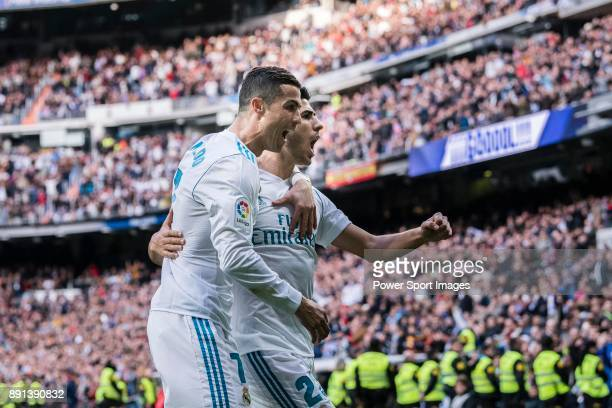 Cristiano Ronaldo of Real Madrid celebrating his score with Marco Asensio of Real Madrid during the La Liga 201718 match between Real Madrid and...