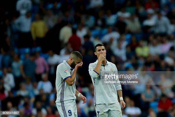 Cristiano Ronaldo of Real Madrid CF and his teammate Karim Benzema reacts after Villarreal CF player Bruno Soriano's opening goal during the La Liga...