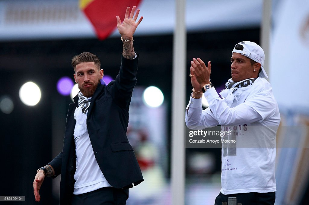 Cristiano Ronaldo (R) of Real Madrid CF and his teammate Sergio Ramos (L) wave the crowd during their team celebration at Cibeles square after winning the Uefa Champions League Final match agains Club Atletico de Madrid on May 29, 2016 in Madrid, Spain.