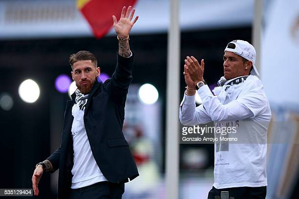 Cristiano Ronaldo of Real Madrid CF and his teammate Sergio Ramos wave the crowd during their team celebration at Cibeles square after winning the...