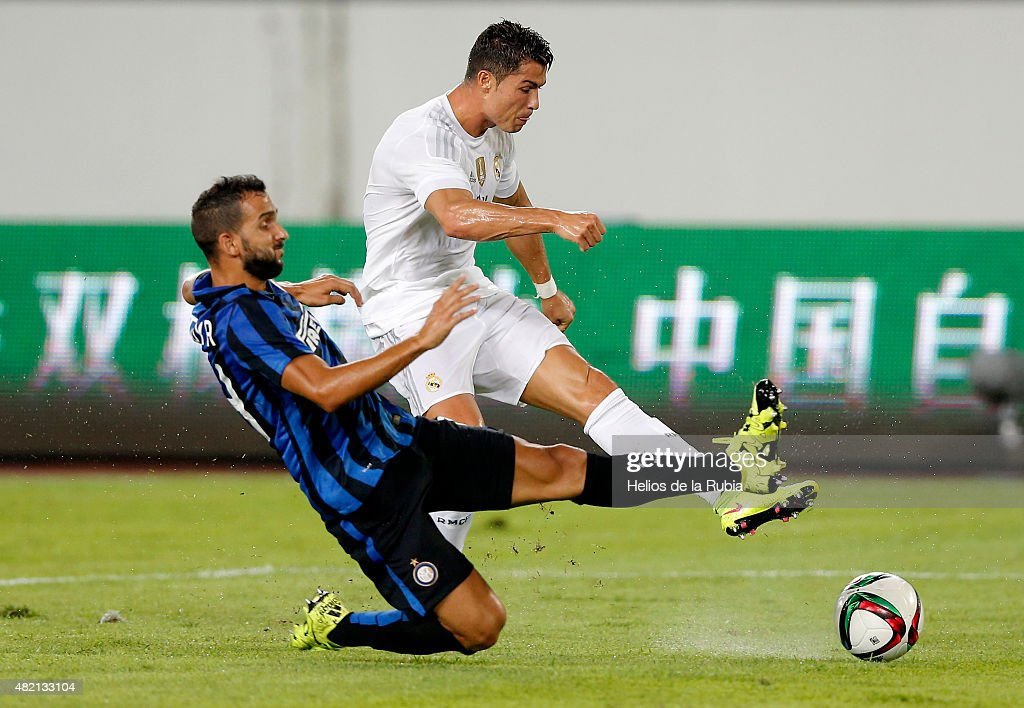 Cristiano Ronaldo (R) of Real Madrid C.F and Martin Montoya of Inter de Milan compete for the ball during the international Champions Cup China match between Real Madrid and Inter de Milan at the Tianhe Stadium on July 27, 2015 in Guangzhou, China.
