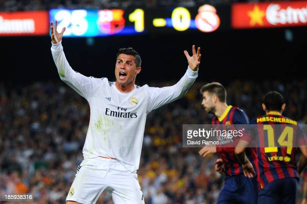 Cristiano Ronaldo of Real Madrid CF argues with the referee after being brought down during the La Liga match between FC Barcelona and Real Madrid CF...
