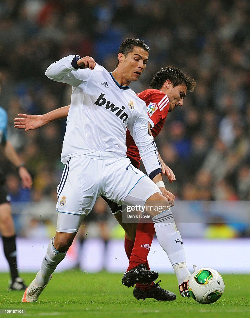 Cristiano Ronaldo (L) of Real Madrid CF battles for the ball against Jonathan Vila of Celta de Vigo during the Copa del Rey round of 16 second leg match between Real Madrid and Celta de Vigo at Estadio Santiago Bernabeu on January 9, 2013 in Madrid, Spain.